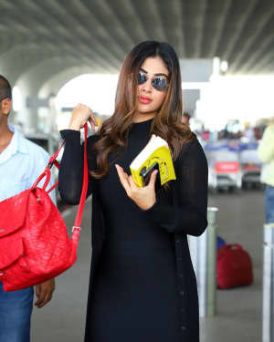 Photos: Celebs Snapped At Airport As They Leave For Filmfare Awards
