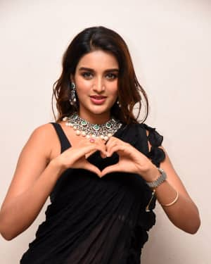 In Pics: Nidhhi Agerwal In Black Saree At Ismart Shankar Pre Release Event | Picture 1662746