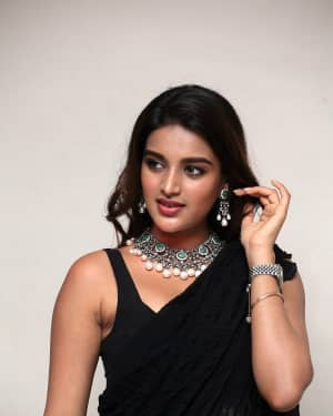 In Pics: Nidhhi Agerwal In Black Saree At Ismart Shankar Pre Release Event | Picture 1662758
