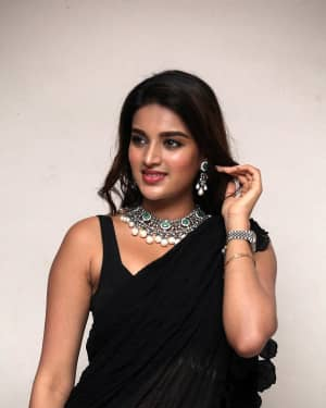 In Pics: Nidhhi Agerwal In Black Saree At Ismart Shankar Pre Release Event | Picture 1662752