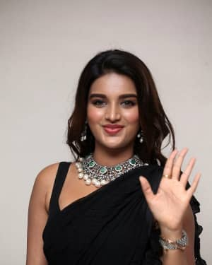 In Pics: Nidhhi Agerwal In Black Saree At Ismart Shankar Pre Release Event | Picture 1662763