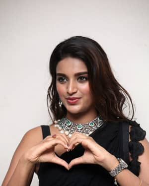 In Pics: Nidhhi Agerwal In Black Saree At Ismart Shankar Pre Release Event | Picture 1662751