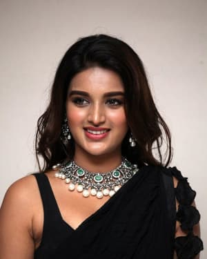 In Pics: Nidhhi Agerwal In Black Saree At Ismart Shankar Pre Release Event